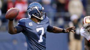 Seahawks quarterback Tarvaris Jackson sneaks away with a sprained ankle