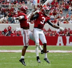 Alabama defensive back Maurice Smith (21) and Alabama defensive back Bradley Sylve (3) celebrate a third quarter touchdown during A-Day at Bryant-Denny Stadium in Tuscaloosa, Ala. on Saturday April 18, 2015. staff photo | Robert Sutton