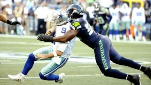 Cliff Avril says Tony Romo told him to not worry about the hit that broke his back
