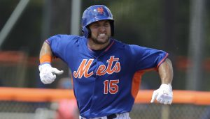 Tim Tebow reacts after hitting a solo home run in his first at bat during the first inning of his first instructional league baseball game for the New York Mets against the St. Louis Cardinals instructional club Wednesday, Sept. 28, 2016, in Port St. Lucie, Fla.  (AP Photo/Luis M. Alvarez)