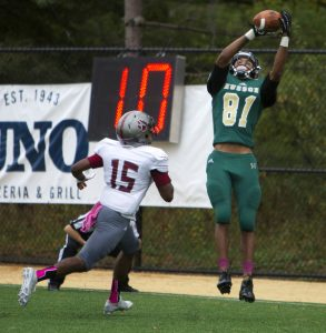 Husson's Kadeem Edge  leaps up to catch the ball in the end zone for a touchdown