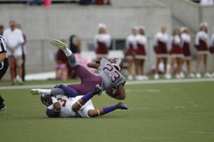Ashland University's Terrell Hudson (3) tackles Walsh University's Kalvin Gordon (23) during college football action Saturday, Sept. 12, 2015 at Tom Benson Hall of Fame Stadium in Canton.